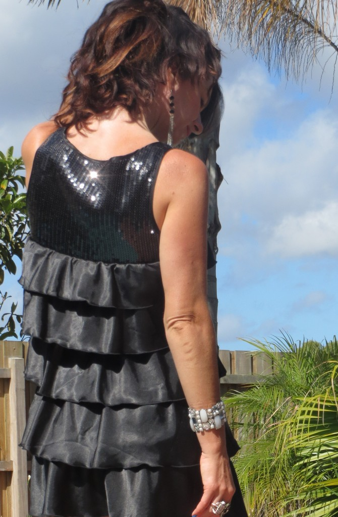 Black ruffle, sequin dress, back close