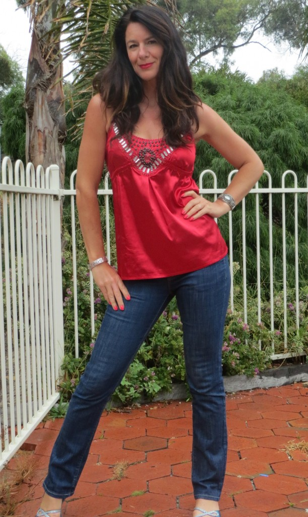 Red silk top, jeans