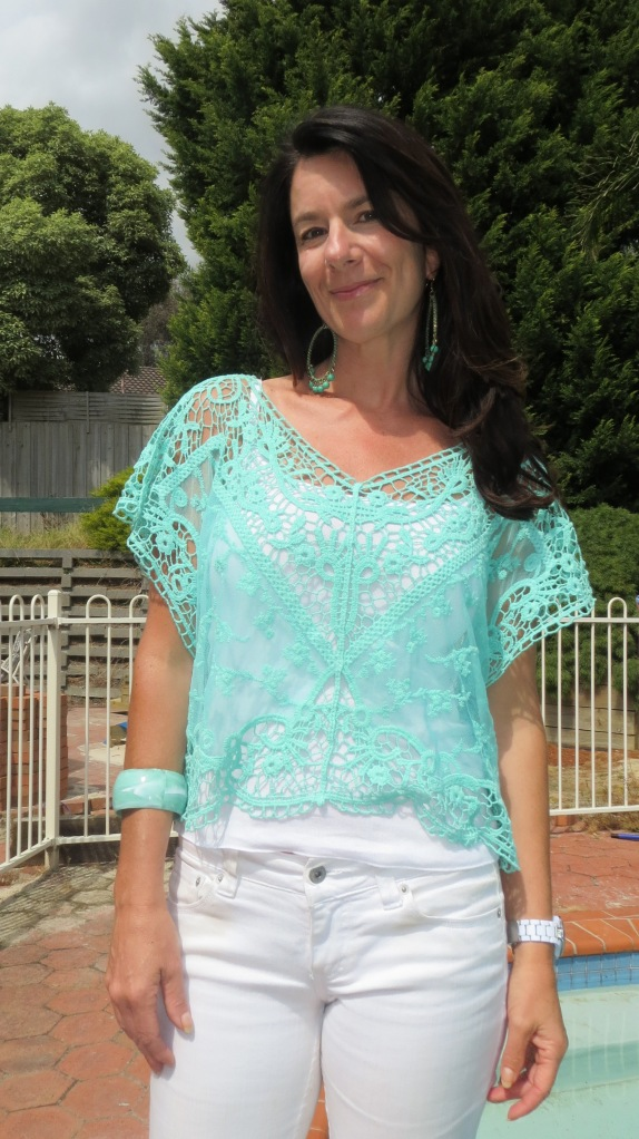 White jeans, green lace top close