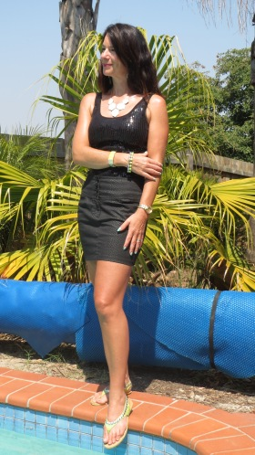 Black ruffle skirt, sequinned top, leather thongs