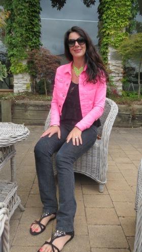 Black snake jeans, neon pink jkt sitting 2