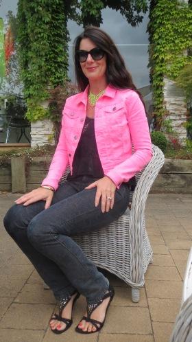 Black snake jeans, neon pink jkt sitting 4