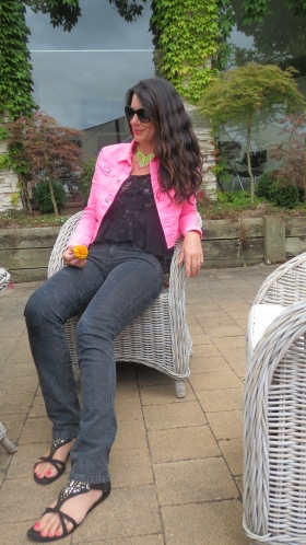 Black snake jeans, neon pink jkt sitting 5