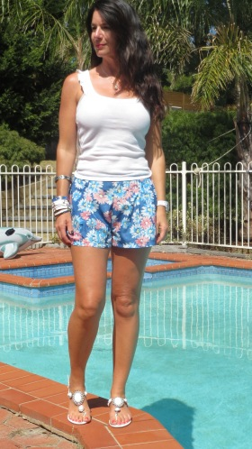 Blue floral shorts, white top 1