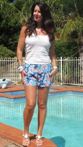 Blue floral shorts, white top 2