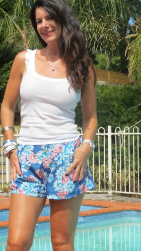 Blue floral shorts, white top close 3