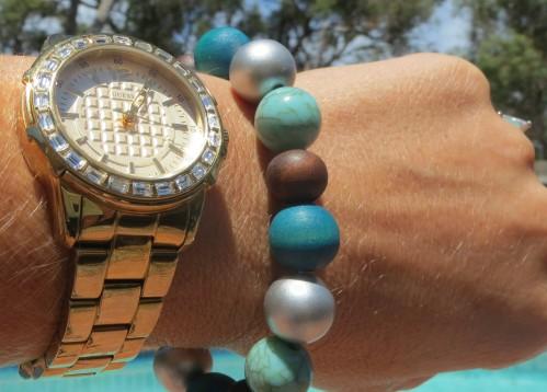 Green beaded bracelet, gold watch
