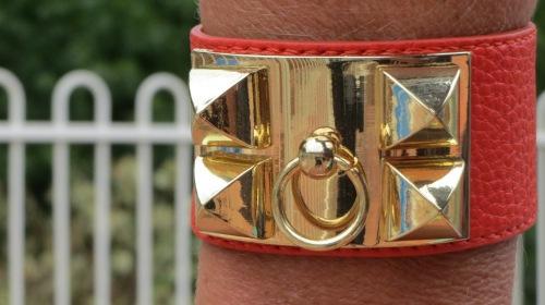 Orange cuff, gold hardware