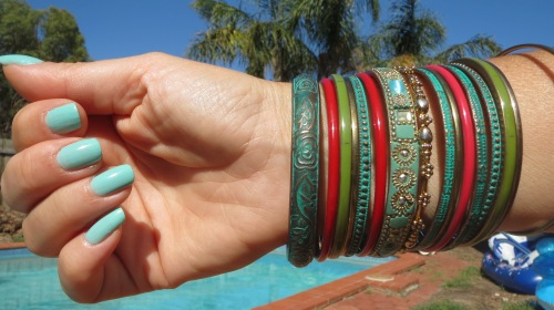 Green & red bracelets, mint nailpolish