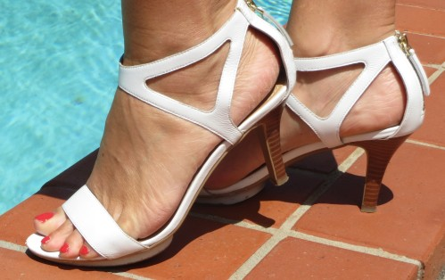 White Nine West heels, poolside