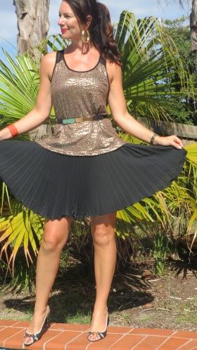 Gold singlet, black pleated skirt 1