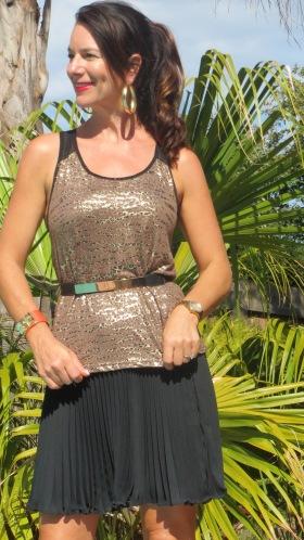 Gold singlet, black pleated skirt 2
