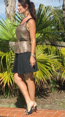 Gold singlet, black pleated skirt 3