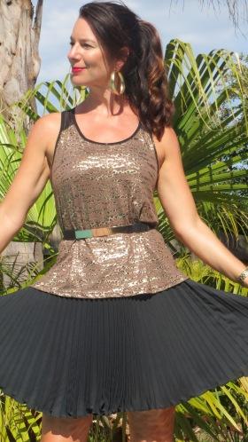 Gold singlet, black pleated skirt 4