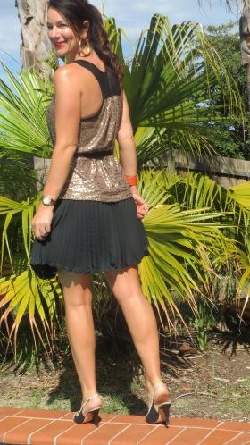 Gold singlet, black pleated skirt 5