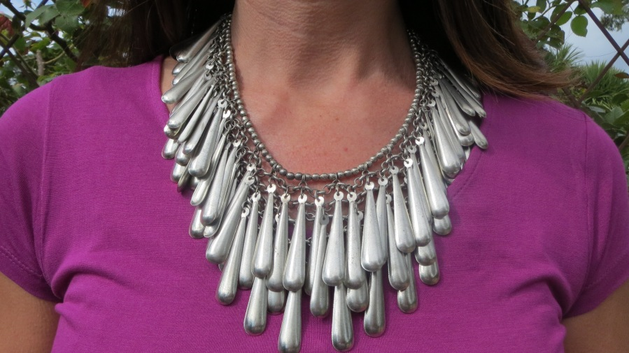 Silver neckpiece on purple top