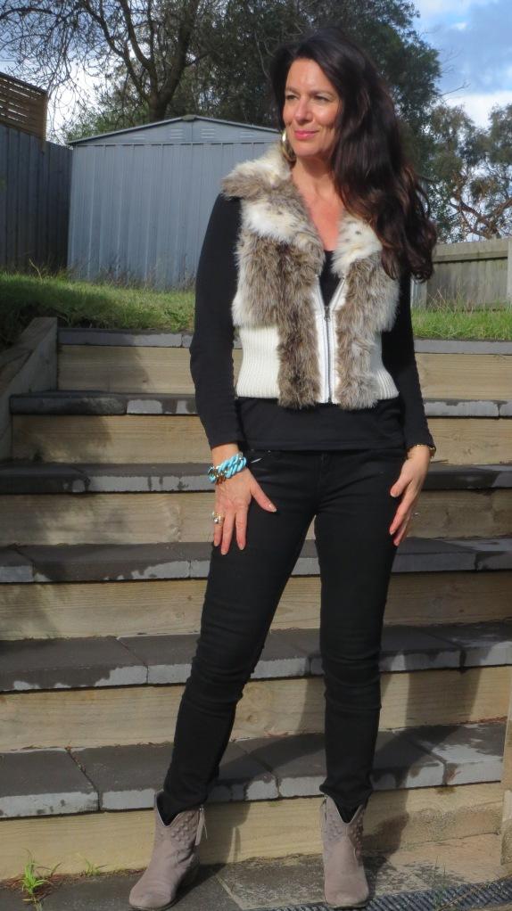 Black jeans, fur vest 1