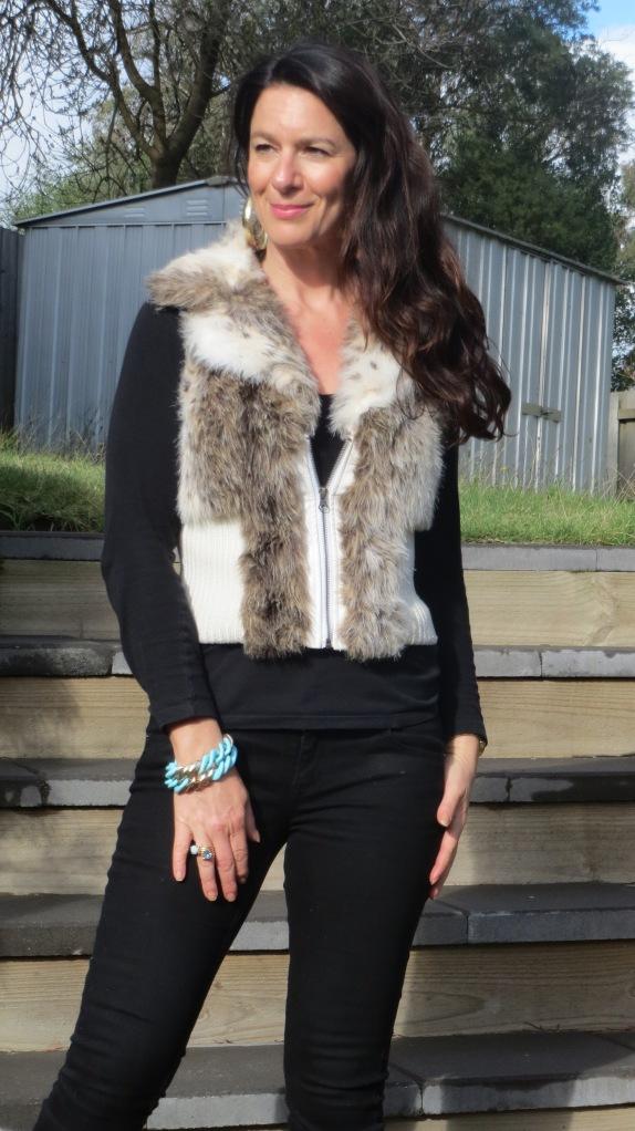 Black jeans, fur vest 2