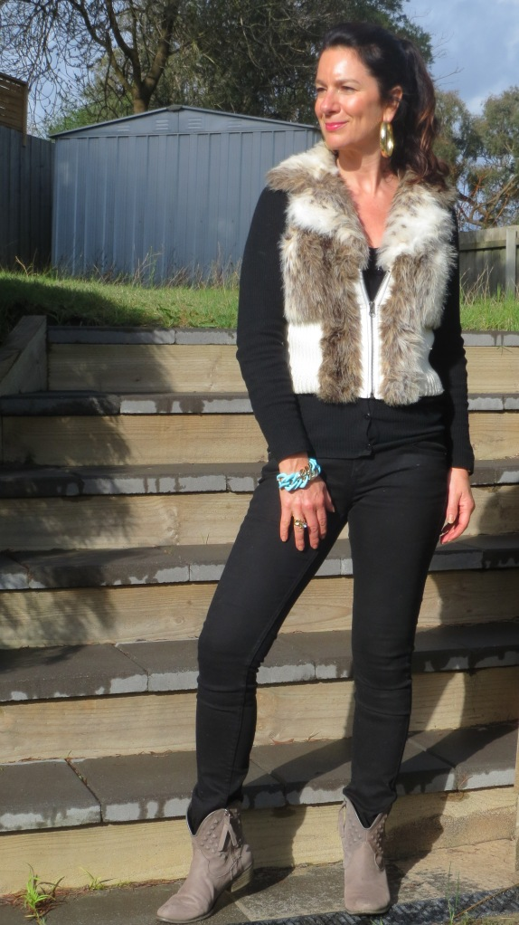 Black jeans, fur vest 3