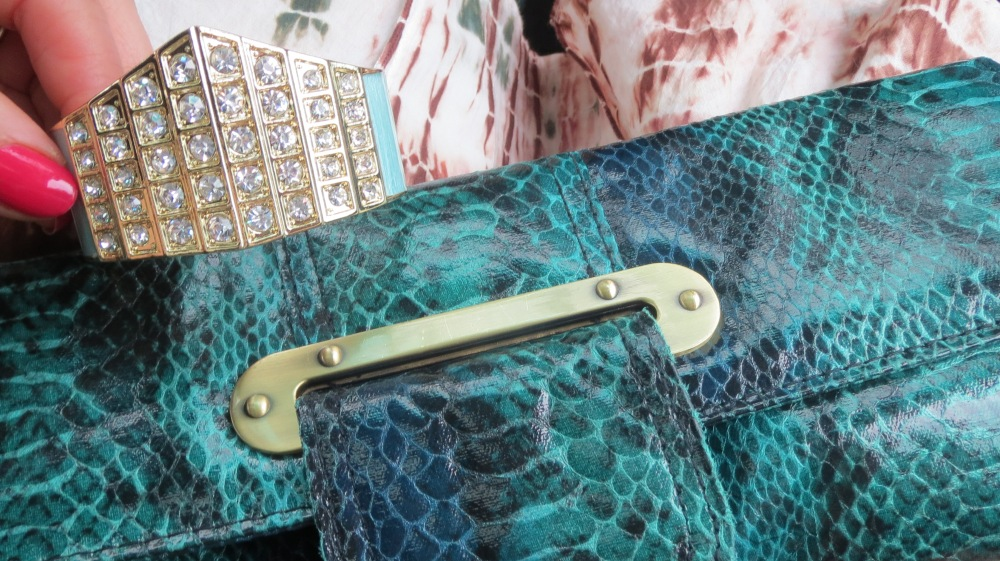 Diamond gold cuff, green snakeskin clutch