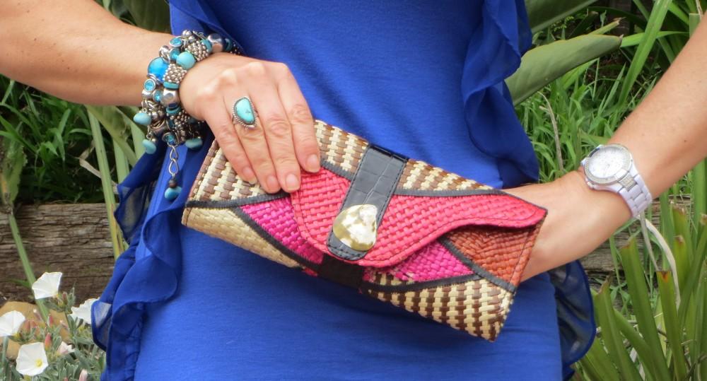 Raffia clutch, blue dress